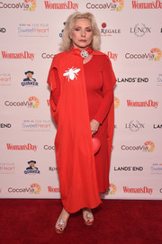 Debbie Harry arrived for the Woman's Day Red Dress Awards wearing an insect-motif cape over a matching frock.