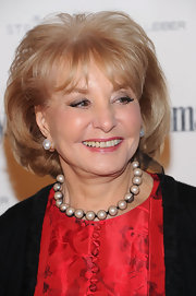 Barbara Walters added a classic touch to her demure look with a string of pearls.
