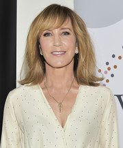 Felicity Huffman sported a mildlly messy 'do with flipped ends and side-swept bangs at the Women in Television Summit.