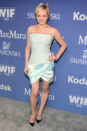 A light teal strapless dress kept Elisabeth Moss looking chic and modern at the Lucy + Crystal Awards.