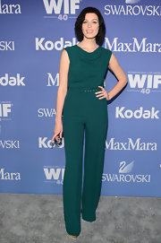 Jessica Pare wore a classic '70s-inspired teal jumpsuit to the Lucy + Crystal Awards.