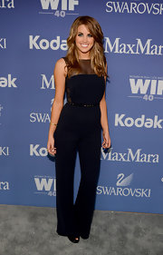 Angie Miller showed off her fit figure with this deep navy jumpsuit.