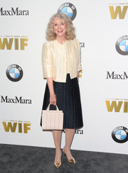 Blythe Danner completed her outfit with a nude leather tote.