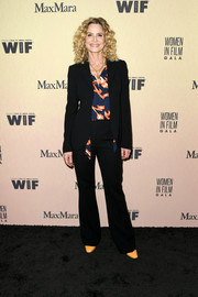Kyra Sedgwick paired a black pantsuit with a print blouse for the 2019 Women in Film Gala.