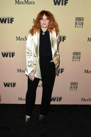 Natasha Lyonne brightened up her black shirt and pants with a gold blazer for the 2019 Women in Film Gala.