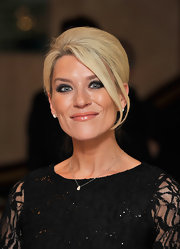Zoe Lucker completed her lace clad dress with a classic French Twist.