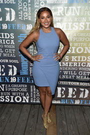 Adrienne Bailon attended Women's Health's Party Under the Stars wearing a sleeveless blue dress with an asymmetrical skirt.
