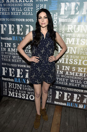 Laura Prepon opted for a pair of lace-up ankle boots to team with her cute romper.