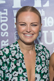 Malin Akerman sported a slicked-down, center-parted updo at the Party Under the Stars.