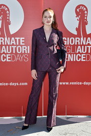 Ellie Bamber opted for a purple patterned pantsuit when she attended the 'Women's Tales' photocall at the Venice Film Festival.