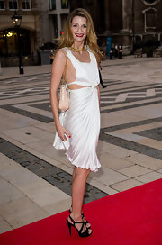 Mischa Barton paired her sexy white frock with strappy black heeled sandals featuring red buckles.