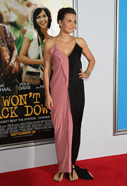 Maggie Gyllenhaal paired her striped sheath dress with simple flat black sandals.