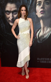 Emily Blunt went for ultra-modern femininity at the 'Into the Woods' screening in a studded white David Koma dress with an asymmetrical hem and a shapely silhouette.