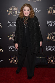 Celia Weston attended the 'Into the Woods' premiere wearing a subtly sparkly black tweed coat.
