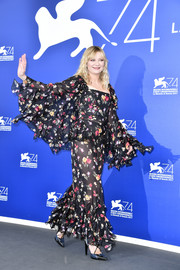 Kirsten Dunst teamed a pair of cross-strap pumps with sheer floral separates for the 'Woodshock' photocall at the Venice Film Festival.