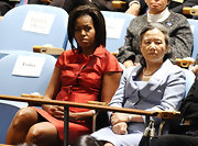 Michelle Obama chose a feminine red silk skirt suit adorned with a bow for the first day of the UN General Assembly.