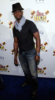 Taye Diggs showed off his muscles in a black vest worn over a fitted t-shirt.