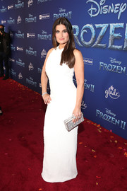 Idina Menzel styled her dress with a beaded silver box clutch.