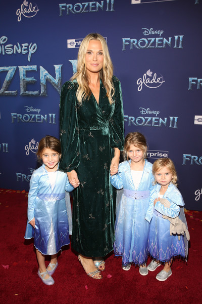 Molly Sims attended the world premiere of 'Frozen 2' wearing a green velvet wrap dress by Divine Heritage.