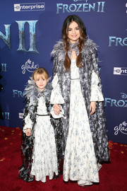 Selena Gomez twinned with her sister in matching sequined and feathered capes by  Marc Jacobs at the world premiere of 'Frozen 2.'