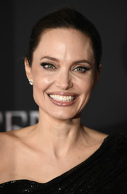Angelina Jolie opted for a simple and classic bun when she attended the world premiere of 'Maleficent: Mistress of Evil.'