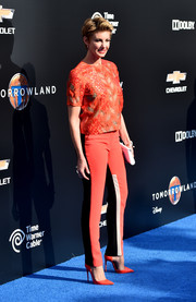 Faith Hill sparkled in a sequined orange top during the world premiere of 'Tomorrowland.'