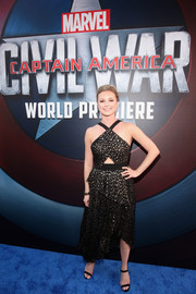 Emily VanCamp chose a black and gold J. Mendel halter dress with peekaboo and peplum detailing for her 'Captain America: Civil War' premiere look.