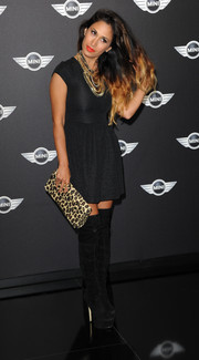 Preeya Kalidas broke her all-black look with a leopard-print clutch.