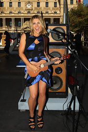 Natalie Bassingthwaighte played a ukelele at an art exhibit wearing a color-block satin dress.