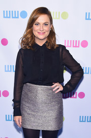 Amy Poehler wore a high-waisted silver mini skirt that brought sparkle to her outfit.