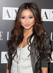 Brenda Song showed off her cascading curls wile hitting the Armani Exchange event.