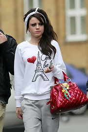 Cher Lloyd vamped up sweat outfit with a patent leather tote bag.