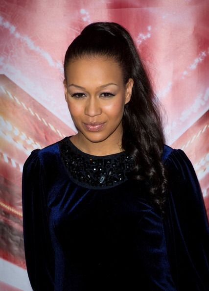 Rebecca Ferguson added a polished touch to her look with a sleek ponytail full of long curls.