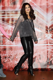 Cheryl rocked a slick pair of leather pants with peep toe booties on the red carpet.
