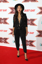 Nicole Scherzinger teamed cropped black slacks with a blazer and a deep-V blouse for the 'X Factor' series 14 launch.