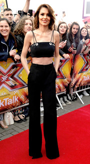 Cheryl Fernandez-Versini teamed her edgy-sexy top with a pair of black wide-leg pants.