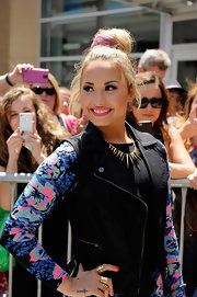 Demi Lavato pulled her newly pink hair up in a thick bun for the 'X Factor' auditions.