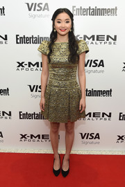 Lana Condor kept it classic and demure in a gold brocade cocktail dress with cap sleeves at the 'X-Men: Apocalypse' New York screening.