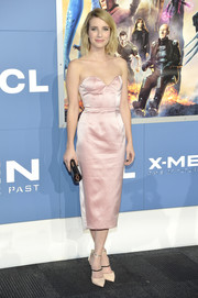 Emma Roberts contrasted her classic frock with modern tricolor strappy pumps by Jimmy Choo.