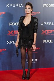 Amaia Salamanca donned an edgy punk look as she wore a fringed sheer dress and a leather jacket at the premiere of 'XP3D.'