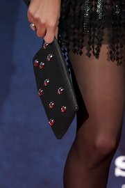 Amaia Salamanca carried a black wristlet with skull studs at the screening of 'XP3D.'