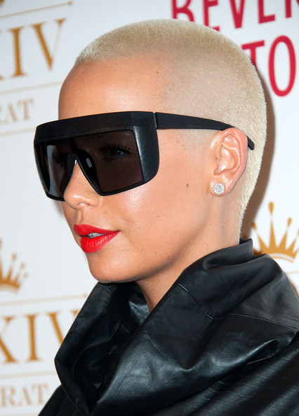 Amber Rose sported a buzzcut and oversized shades at the XXIV Karat's launch party.