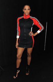 Ciara made a sporty appearance in this track jacket dress with a bra type inset. She matched her zip-up dress with a pair of zip-up gladiator heels.