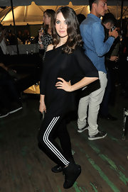 Alison Brie went for an athletic look with black basketball sneakers and leggings at the Y-3 fashion show.
