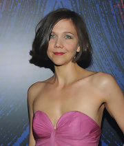 The actress wore a slightly curled under, side-parted bob with berry pink lipstick and a bare neckline.