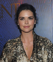Katie accessorized her printed frock with a gold leaf pendant.