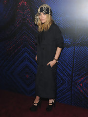 Ashley wore chic cap toe ankle booties with delicate buckled straps.