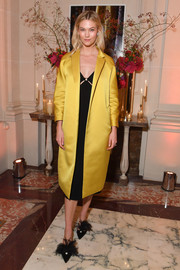 Karlie Kloss layered a yellow Martin Grant silk coat over a little black dress for the YouTube cocktail party during Paris Fashion Week.