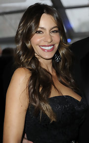Sofia Vergara wore her hair in her signature sexy style featuring long tousled waves.