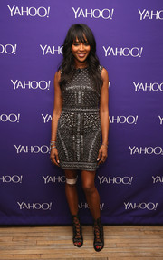 Naomi Campbell amped up the fierceness with a pair of gray gladiator heels.